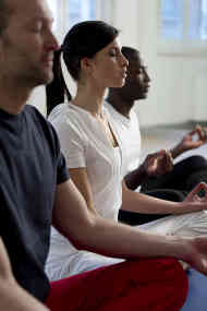 Image of people sitting and meditating